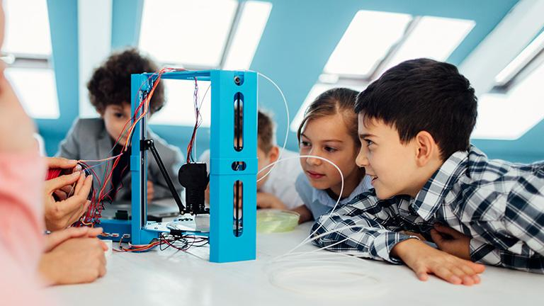 A group of kids exploring technology in the classroom